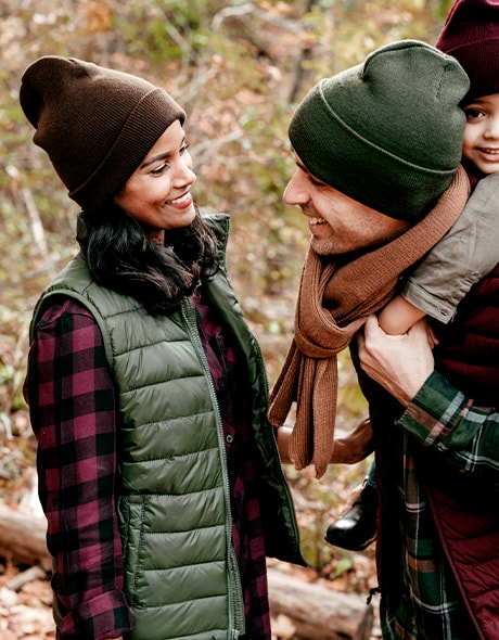 Couple walking outdoors with their young son