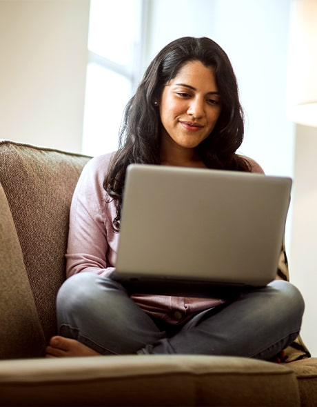 Woman makes an online purchase on her laptop