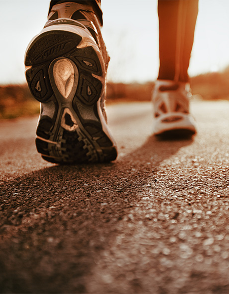 Close up of running shoes on a road